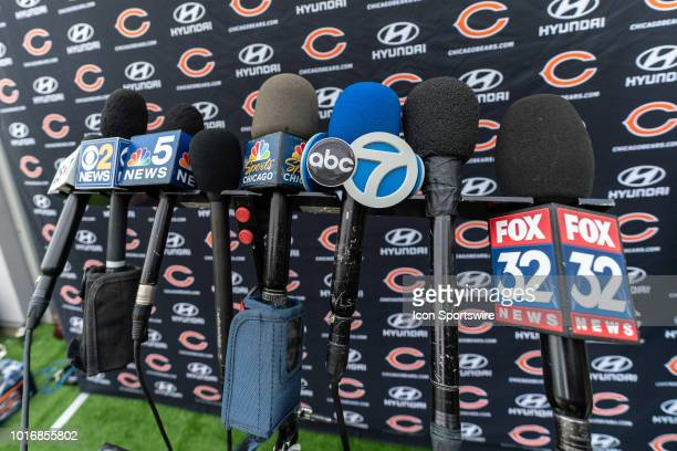 A detailed view of news channel microphones are seen lined up together to record the press conference of Chicago Bears head coach Matt Nagy and...