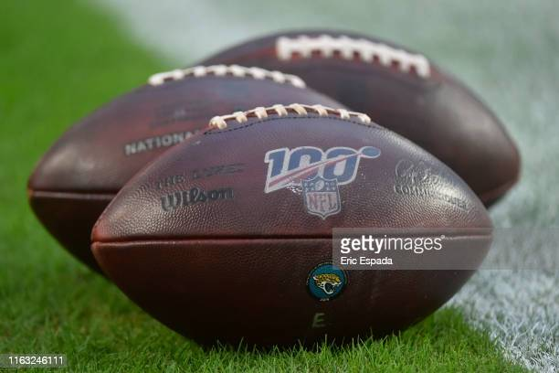 A detailed view of NFL footballs with the 100 seasons logo on them before the start of the game between the Miami Dolphins and Jacksonville Jaguars...