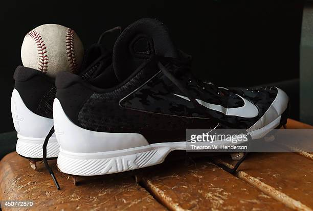 A detailed view of Nike Baseball cleats belonging to a player of the Colorado Rockies sitting on the bench in the dugout prior to the game against...
