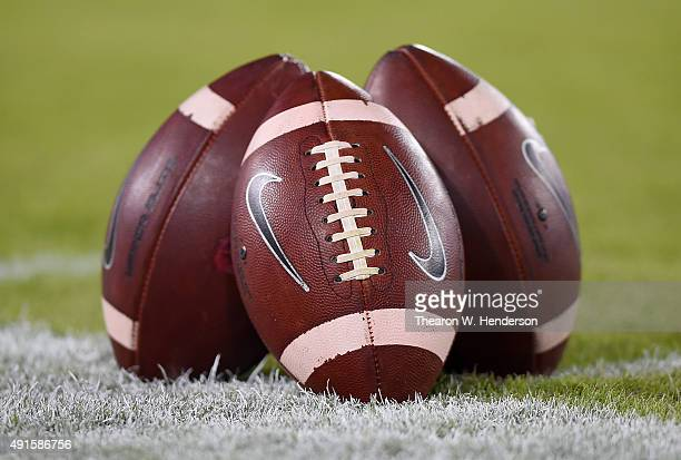 A detailed view of Nike footballs sitting on the Stanford Cardinal sideline during pregame warm ups prior to playing the Arizona Wildcats in a NCAA...