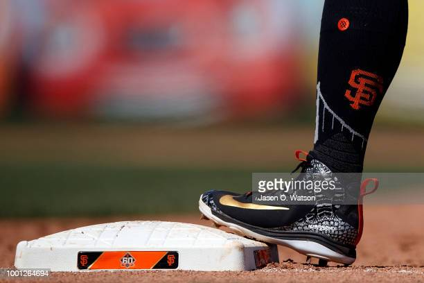 Detailed view of Nike Hurricane baseball cleats worn by Andrew McCutchen of the San Francisco Giants while standing on first base against the Oakland...