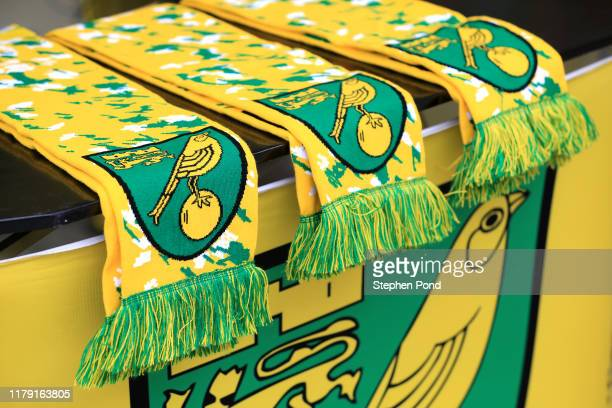 Detailed view of Norwich City scarves are seen outside the stadium prior to the Premier League match between Norwich City and Aston Villa at Carrow...