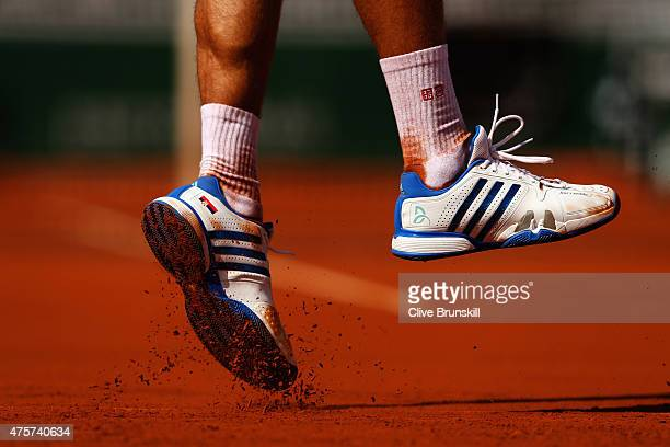 A detailed view of Novak Djokovic of Serbia's shoes during his Men's quarter final match against Rafael Nadal of Spain on day eleven of the 2015...