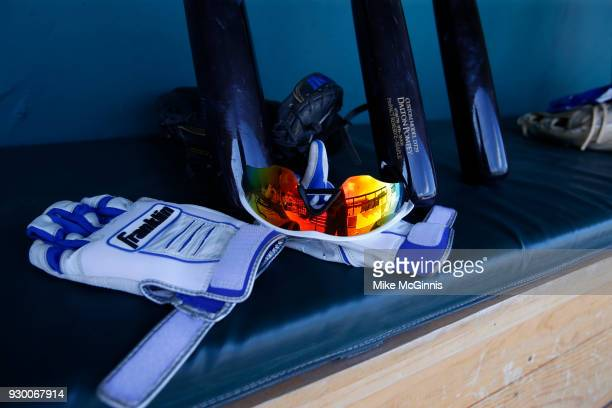 A detailed view of Oakley sunglasses Franklin batting gloves and bat of Dalton Pompey of the Toronto Blue Jays in the dugout before the Spring...