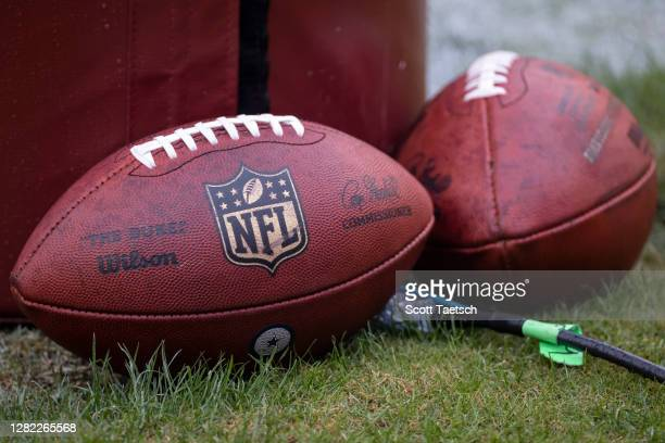 Detailed view of official NFL footballs with a Dallas Cowboys logo before the game between the Washington Football Team and the Dallas Cowboys at...