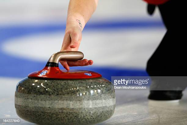 A detailed view of Olympic rings tattoo on the wrist of Stella Heiss of Germany as she throws a stone in the match between Germany and Sweden on Day...