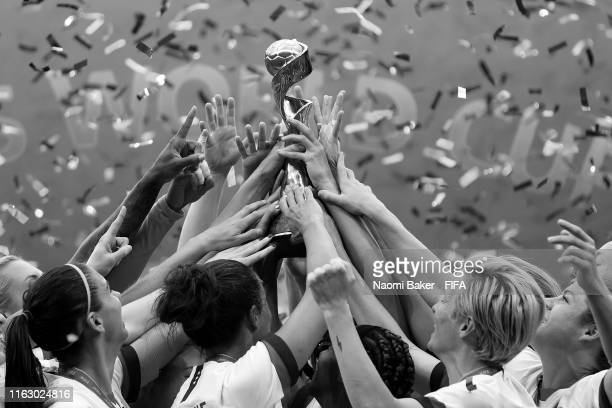 A detailed view of players from USA lift the FIFA Women's World Cup Trophy following her team's victory the 2019 FIFA Women's World Cup France Final...