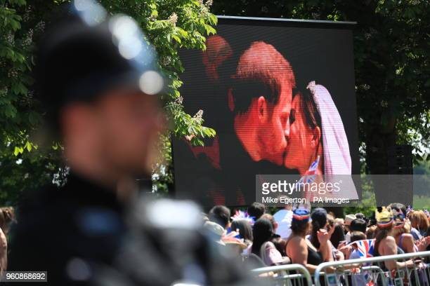 A detailed view of Prince Harry and Meghan Markle kissing on the big screen after their wedding in St George's Chapel in Windsor Castle
