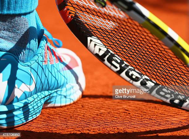 A detailed view of Rafael Nadal of Spain's shoe and raquet ahead of his Men's quarter final match against Novak Djokovic of Serbia on day eleven of...