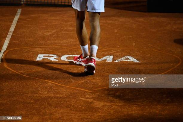 Detailed view of 'Roma' writing on the court as Novak Djokovic of Serbia walks over to pose for a picture after winning his men's final match against...