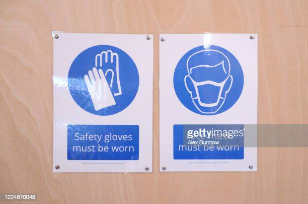 A detailed view of safety warning signs which are displayed on the wall in the Church Crookham and Fleet Men's Shed on May 06 2020 in Church Crookham...