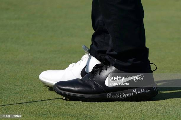 """Detailed view of shoes worn by Cameron Champ of the United States read """"Black Lives Matter"""" as seen during the first round of the BMW Championship on..."""