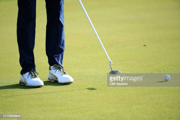 Detailed view of shoes worn by Rickie Fowler of the United States are seen as he putts on the 13th green during the first round of The PLAYERS...