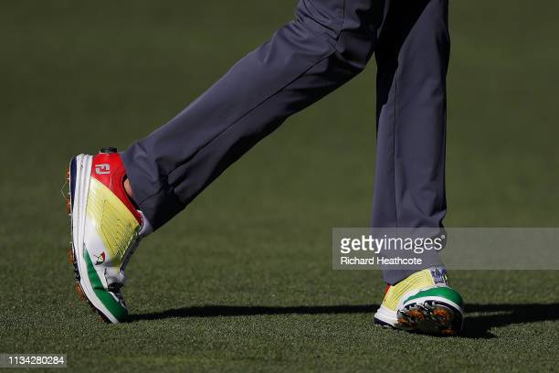 A detailed view of shoes worn by Sam Saunders of the United States are seen as he walks the 11th hole during the first round of the Arnold Palmer...