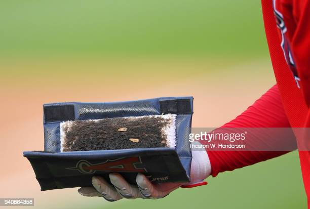 A detailed view of Shohei Ohtani of the Los Angeles Angels of Anaheim holding the pine tar rag during batting practice prior to the start of a Major...