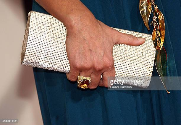 A detailed view of singer/actress Tia Carrere's jewelry and hand bag is seen as she arrives at the 50th annual Grammy awards held at the Staples...