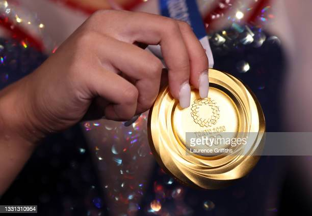 Detailed view of Sunisa Lee of Team United States holding her gold medal after winning the Women's All-Around Final on day six of the Tokyo 2020...