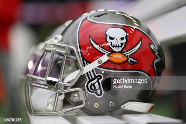 Detailed view of Tampa Bay Buccaneers helmets on the team bench ahead of the NFL game between Carolina Panthers and Tampa Bay Buccaneers at Tottenham...