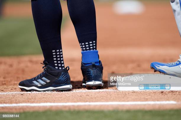A detailed view of the Adidas baseball cleats worn by Miguel Cabrera of the Detroit Tigers at first base during the Spring Training game against the...