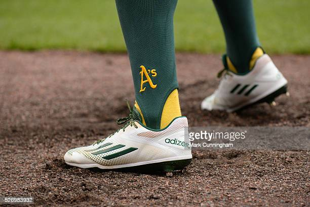 A detailed view of the Adidas baseball shoes worn by Billy Burns of the Oakland Athletics as he waits ondeck to bat during the game against the...