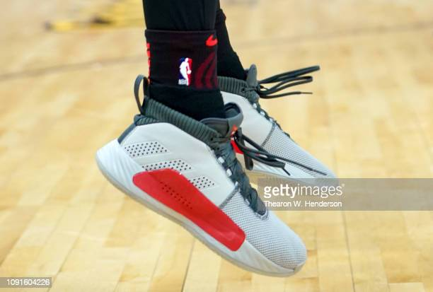 A detailed view of the Adidas basketball shoes worn by Damian Lillard of the Portland Trail Blazers against the Sacramento Kings during an NBA...