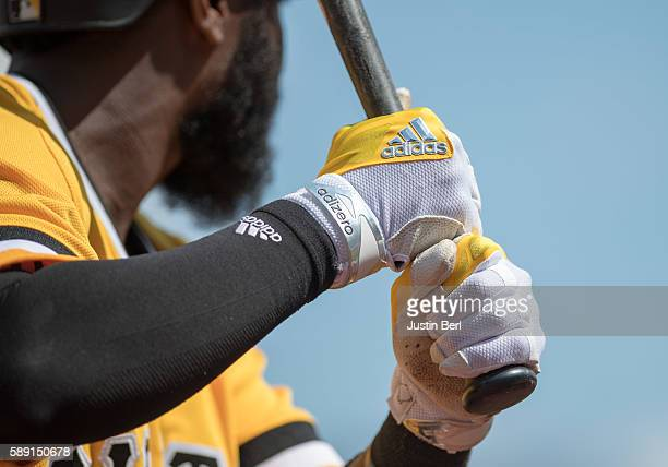 A detailed view of the Adidas batting gloves worn by Josh Harrison of the Pittsburgh Pirates during the game against the Cincinnati Reds at PNC Park...