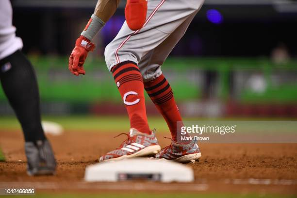 A detailed view of the Adidas cleats and Stance socks wornby Billy Hamilton of the Cincinnati Reds against the Miami Marlins at Marlins Park on...