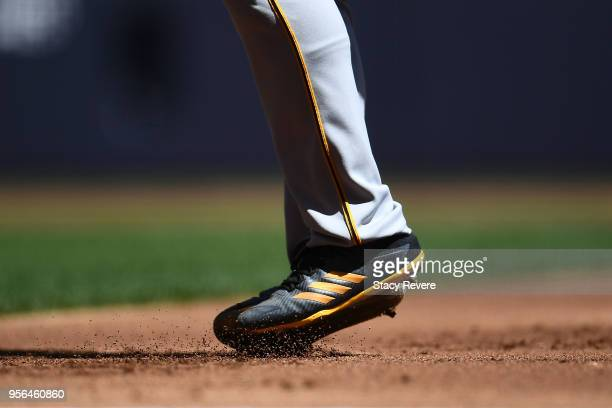 A detailed view of the Adidas cleats worn by Josh Bell of the Pittsburgh Pirates during a game against the Milwaukee Brewers at Miller Park on May 6...
