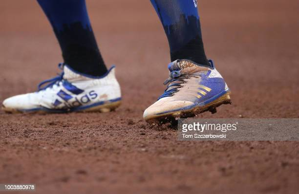 A detailed view of the Adidas cleats worn by Kevin Pillar of the Toronto Blue Jays as he leads off first base in the fourth inning during MLB game...