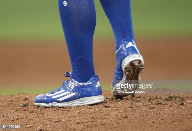 A detailed view of the Adidas cleats worn by Roberto Osuna of the Toronto Blue Jays before he delivers a pitch in the ninth inning during MLB game...