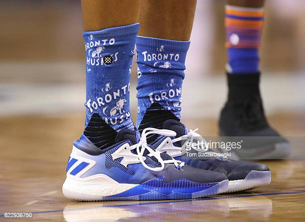 A detailed view of the Adidas shoes worn by Kyle Lowry of the Toronto Raptors who also wears socks with the throwback Huskies logo during NBA game...