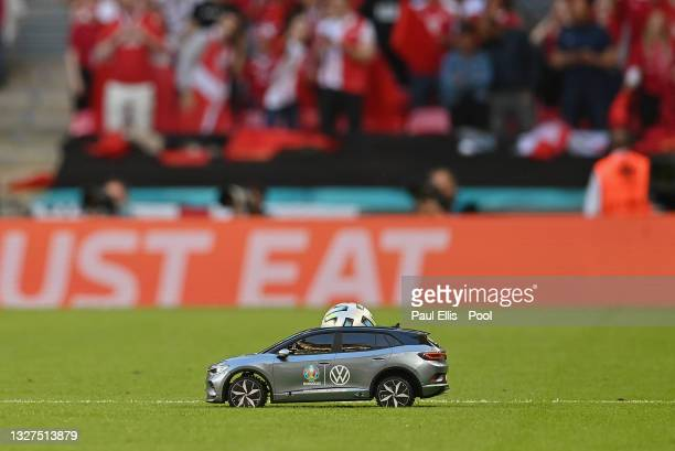 Detailed view of the Adidas Uniforia match ball is seen in the Volkswagen Remote Control Mini Car as it is delivered on to the pitch prior to the...