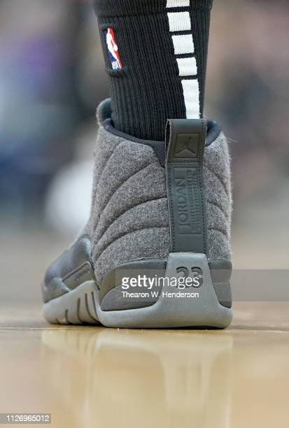 A detailed view of the Air Jordan XII's basketball shoes worn by Omari Spellman of the Atlanta Hawks during an NBA basketball game against the...