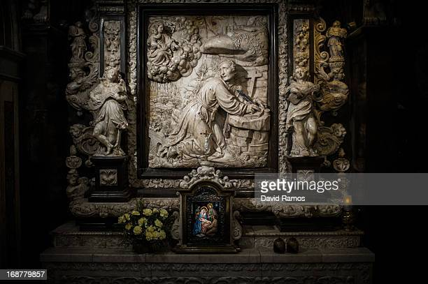 A detailed view of the altarpiece shows Saint Ignatius of Loyola writing the Spiritual Excercises at the Cave of Saint Ignatius of Loyola on May 2...