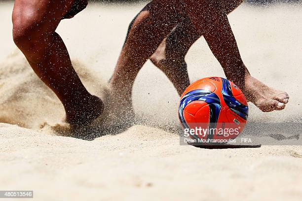 A detailed view of the ball feet and legs as Jair Aleman of Mexico battles for the ball with Pajon of Spain during the Group C FIFA Beach Soccer...