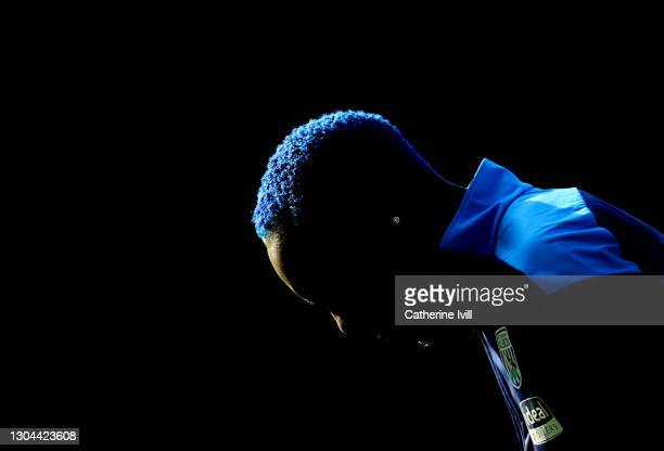 Detailed view of the blue hair of Mbaye Diagne of West Bromwich Albion as he warms up ahead of the Premier League match between West Bromwich Albion...