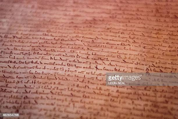 A detailed view of the British Library's original copy of the London Magna Carta is pictured during a photocall at the British Library in London on...