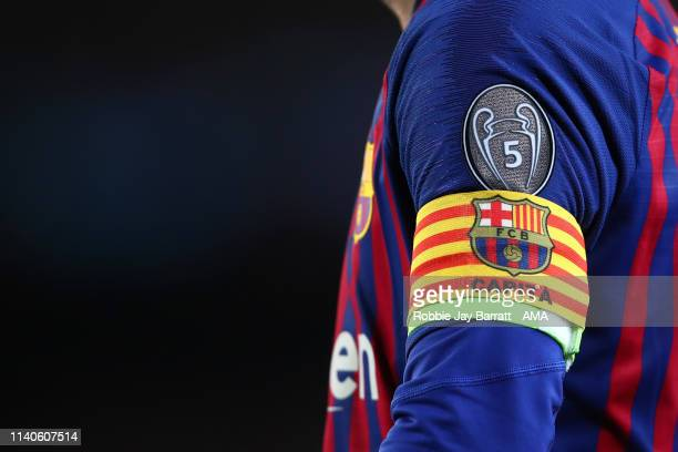 Detailed view of the captains armband and UEFA Champions League badge celebrating 5 trophies on Lionel Messi of FC Barcelona during the UEFA...