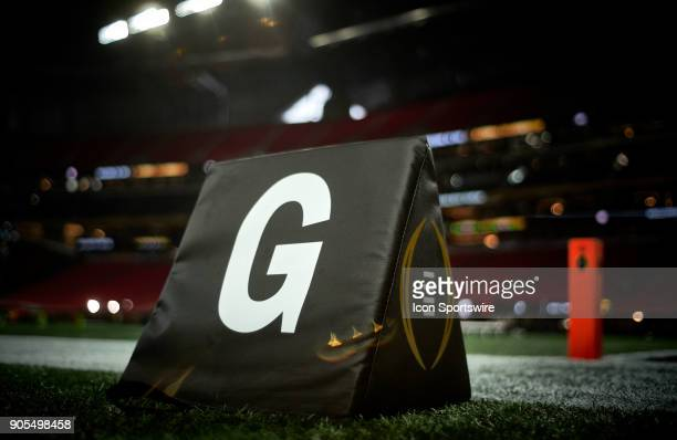 A detailed view of the CFP logo on the goal line field marker is seen during the CFP National Championship presented by ATT between the Georgia...