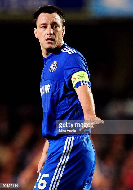 A detailed view of the Chelsea badge and 'Unite Against Racism' captain's armband worn by John Terry during the UEFA Champions League Group D match...