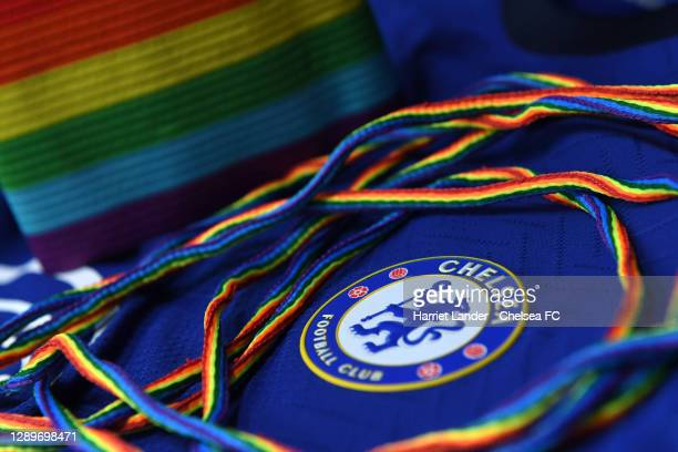 Detailed view of the Chelsea badge is seen alongside a pair of Stonewall Rainbow Laces and a rainbow coloured captain's armband as the club support...
