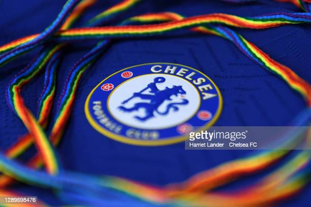 Detailed view of the Chelsea badge is seen alongside a pair of Stonewall Rainbow Laces as the club support the campaign inside the dressing room...