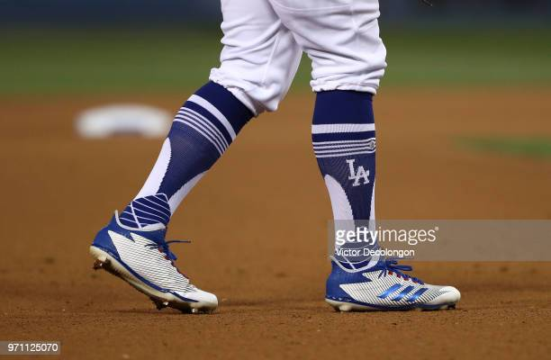 A detailed view of the cleats of Enrique Hernandez of the Los Angeles Dodgers is seen in the eighth inning during the MLB game between the Miami...