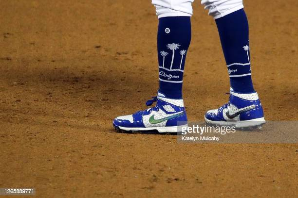 A detailed view of the cleats of Mookie Betts of the Los Angeles Dodgers during the sixth inning against the San Francisco Giants at Dodger Stadium...