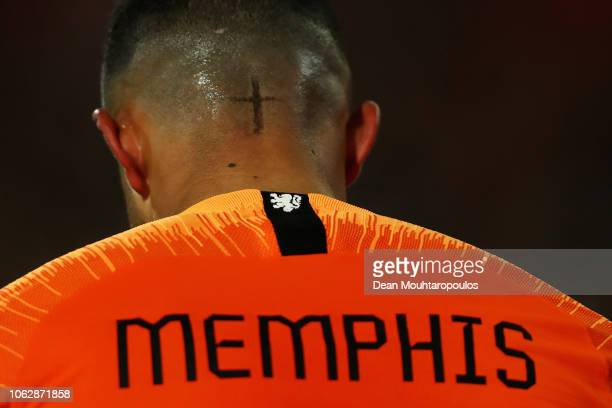 A detailed view of the cross cut into the hair of Memphis Depay of the Netherlands during the UEFA Nations League A group one match between...
