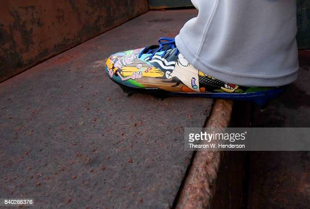 A detailed view of the custom design baseball cleats worn by Delino DeShields of the Texas Rangers against the Oakland Athletics at Oakland Alameda...