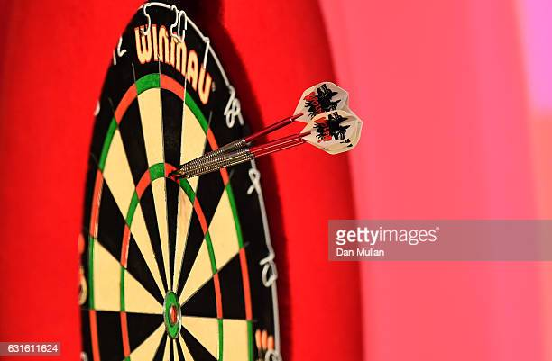 A detailed view of the darts of Martin Adams of England scoring 180 during his Mens Quarter Final match against Jamie Hughes of England on day seven...