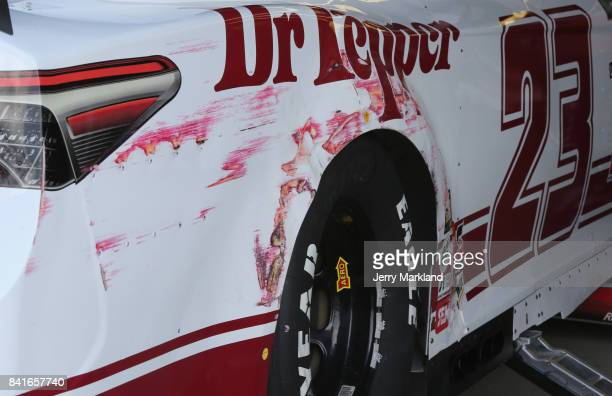 A detailed view of the Dr Pepper Toyota driven by Corey LaJoie after scraping the wall during practice for the Monster Energy NASCAR Cup Series...