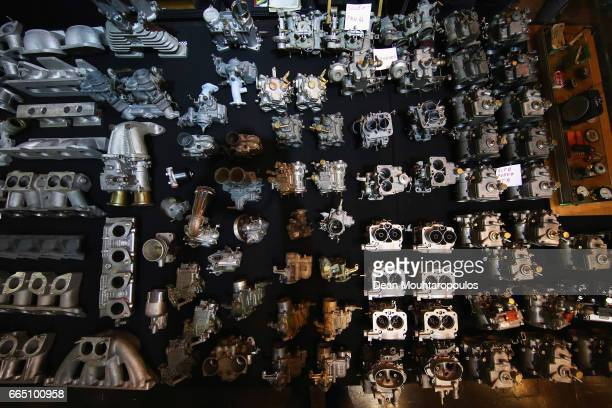 A detailed view of the engine parts like a slection of carburetors or carburettors during the The 29th TechnoClassica Essen run by SIHA Salons...