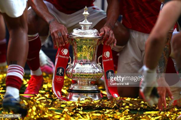Detailed view of the FA Cup Trophy as it sits in the pitch surrounded by Arsenal players after the FA Cup Final match between Arsenal and Chelsea at...